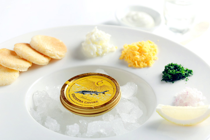 30 g of Russian Oscietra Caviar with Classic Condiments and a Shot of Beluga Noble Vodka